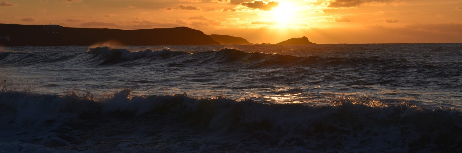 An image of the Cornish beach at sunset